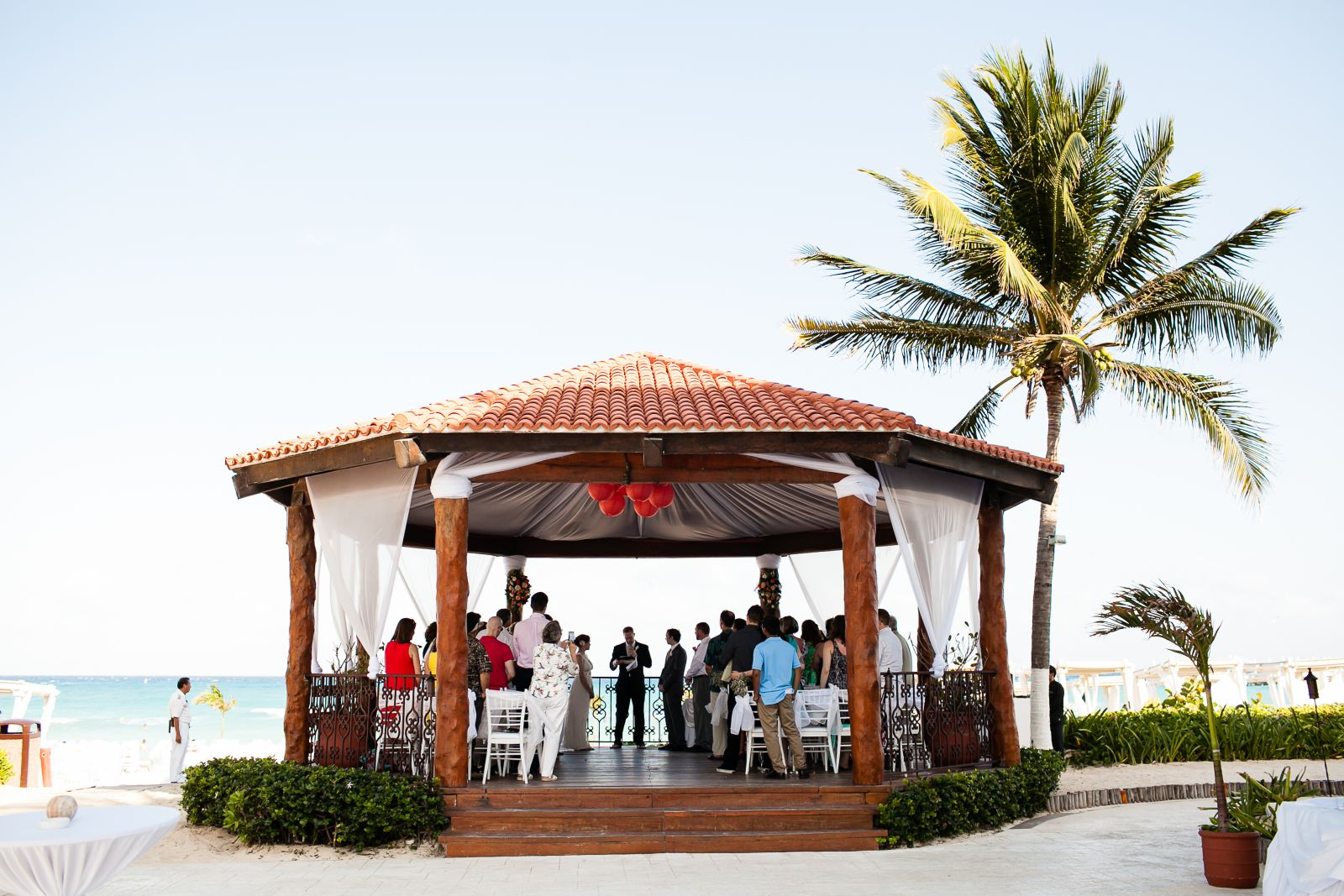 """Wedding Gazebo at The Royal Playa del Carmen...the sheer white panels of fabric are already installed for you and you can decide how you want them to hang (free flowing vs. the """"tied back"""" look I went with).  We fit 40 guests in the gazebo with us and i"""