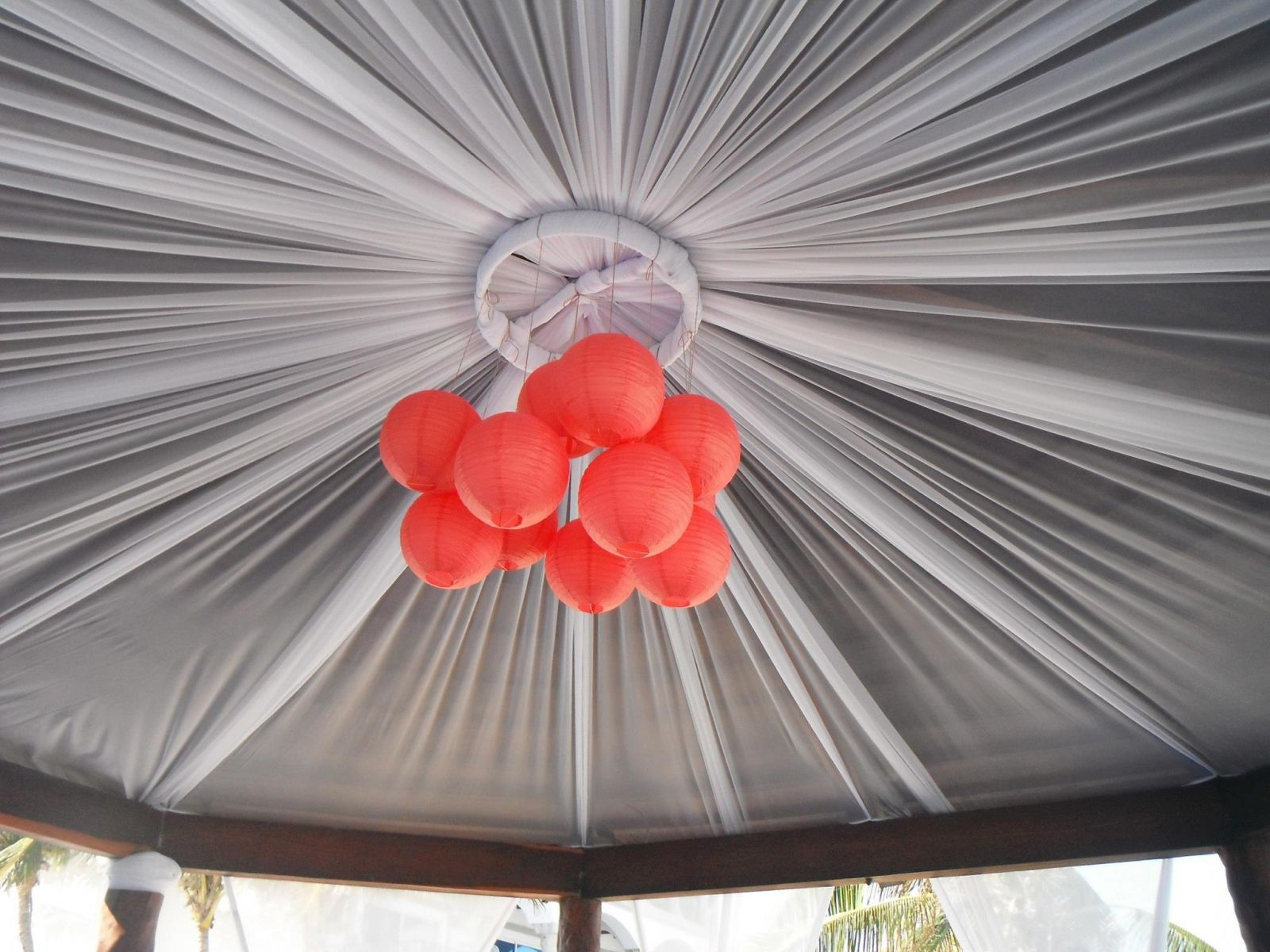 I ordered these coral-colored paper lanterns from Koyal Wholesale - the Royal wedding staff hung them in a cluster from the top of their Wedding Gazebo (which was the way I had requested)
