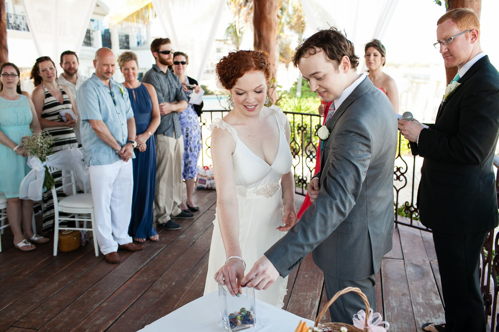 """We had a simple 20-minute ceremony. In lieu of a sand ceremony we opted for a """"stone ceremony"""". We brought glass stones with us and had them in a basket, each guest took one when getting seated for the wedding. Then, during the wedding we invited each of"""