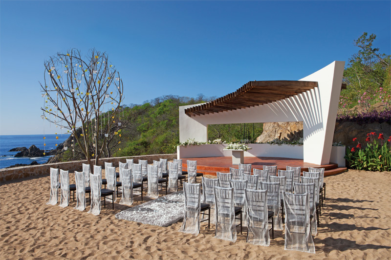 www.crystalwaterweddings.com Experienced travel agents who strongly value providing first class service and have a deep passion for destination weddings.  Secrets Huatulco Resort & Spa.  Couples can tie the knot on the golden sand beach under a modern ga
