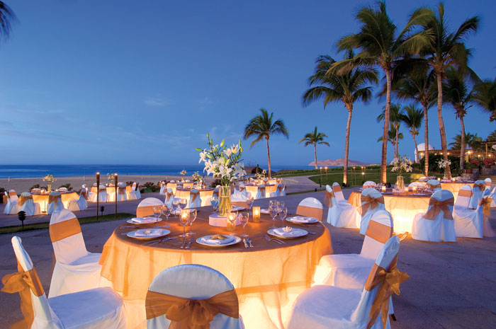 www.crystalwaterweddings.com Experienced travel agents who strongly value providing first class service and have a deep passion for destination weddings.  Dreams Los Cabos Suites Golf Resort & Spa.  Elegant dinner set-up on the beach for a Gala Event.
