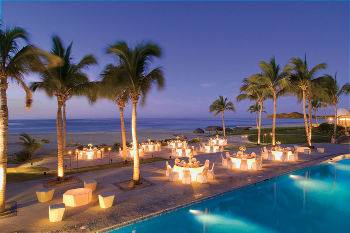 www.crystalwaterweddings.com Experienced travel agents who strongly value providing first class service and have a deep passion for destination weddings.  Dreams Los Cabos Suites Golf Resort & Spa.  A nighttime aerial shot of the Gala Event featuring the
