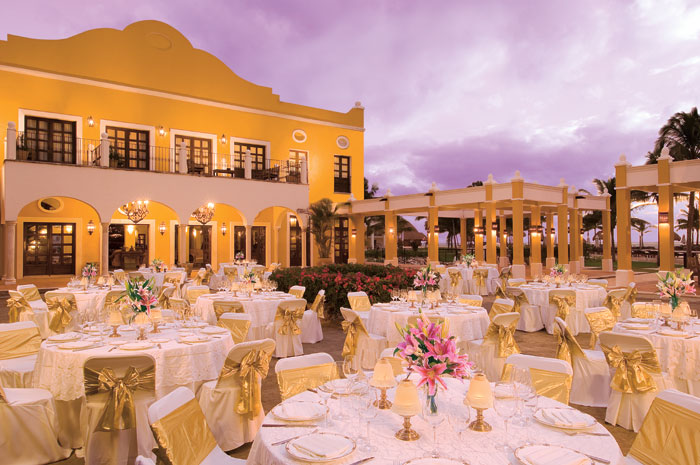 www.crystalwaterweddings.com Experienced travel agents who strongly value providing first class service and have a deep passion for destination weddings.  Dreams Tulum Resort & Spa. Group dinner set-up outside offering stunning views of the Caribbean suns
