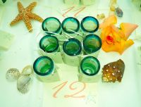Shot glasses for each guest as a souvenir with names engraved by hand.