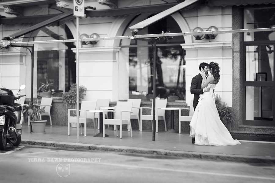 The bride and groom pose in front of the Lido Palace in Santa Margherita, Italy.