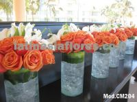 orange roses and white oriental lilies centerpiece