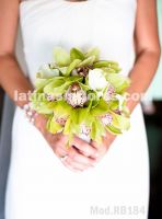 apple green cymbidium orchids and white calla lilies, semiround bouquet wrapped with white satin ribbon.