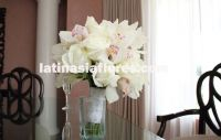White bouquet. combination of roses and cymbidium orchids