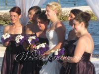 calla lilies and deep purple lisianthus bouquets