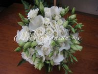 Mexican calla lilies (alcatraces), baby roses and lisianthus wedding bouquet.
